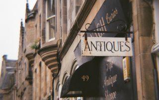 """""""Antiques"""" sign outside shop"""